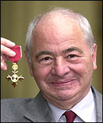 Colin Dexter with his OBE award