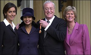 Michael Caine with his wife Shakira and daughter Natasha, left, and Dominique, a daughter from a previous marriage