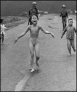 Phan Thi Kim Phuc flees after a misdirected aerial napalm attack on a suspected Viet Cong hiding place