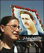 Syrian woman with Bashar banner