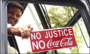 Former Coke employee takes part in protest