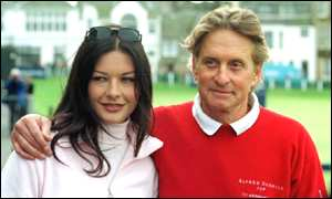 Zeta Jones and Michael Douglas at a golf event