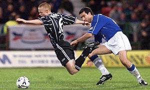 Tony Vidmar pulls down fellow full-back Chris McGroarty
