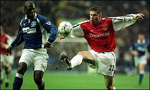 Kevin Campbell and Oleg Luzhny