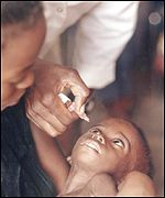 Angolan child being immunised