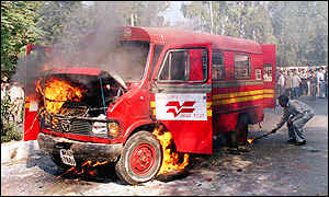 Burning postal van in Delhi street