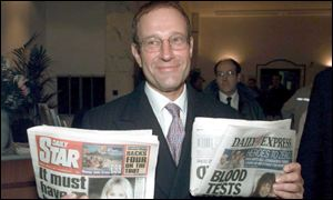 Richard Desmond with his new titles