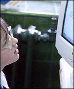 Child looking at a computer