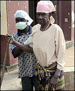 An Ebola suspect being assisted to a local hospital