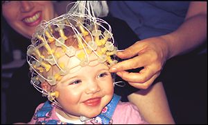 Baby Rebecca giggling with the electronic net on her head