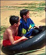 Two boys in floodwaters in Terengganu