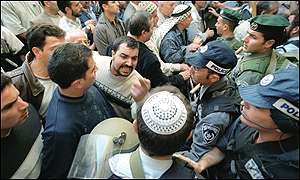 Israeli police argue with Palestinians before Friday prayers