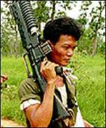 Cambodian soldier with gun