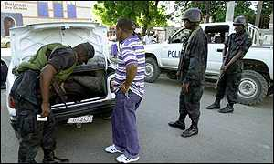 police checking a vehicle in Port-au-Prince