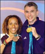 Jonathan Edwards with fellow medallist Kelly Holmes