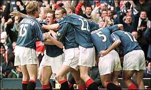 Rangers celebrate on the road to their 5-1 victory