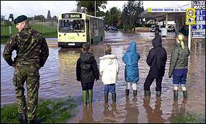 children wait for bus