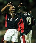 Dwight Yorke and Quinton Fortune celebrate