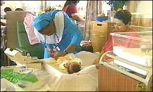 Midwife checking a baby