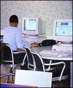 Internet cafe - person sviewing websites