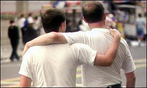 Two men embracing