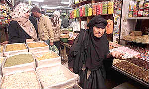 Iraqis buy sweets, nuts and dried fruits in a Baghdad market