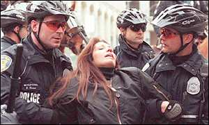Seattle police arrest an anti-WTO demonstrator