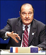 French President Jacques Chirac speaks to reporters at the summit