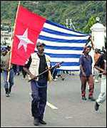 Locals in Irian Jaya with the banned Morning Star flag