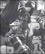 Cosmonaut Yuri Gidzenko, bottom centre, and commander Bill Shepherd
