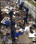 Police sift through refuse