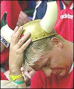 Norwegian football fan in a Viking helmet