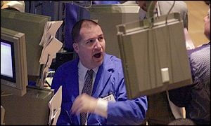 Trader at the New York Stock Exchange on Tuesday