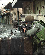 Israeli soldier taking aim in Hebron