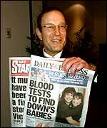 Richard Desmond with newspapers