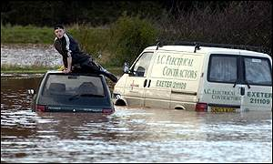 Two vehicles trapped in floods