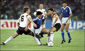 Diego Maradona surrounded by West German players