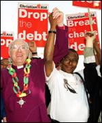 Archbishop of Canterbury George Carey joins debt campaigners