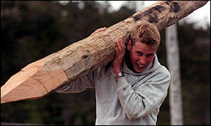 Prince William carries a log
