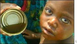 Child at an African feeding station