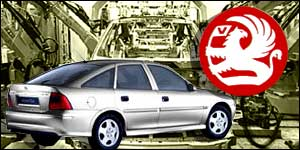 Vauxhall Vectra and car badge against factory background