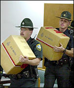 Florida State Troopers carry ballots