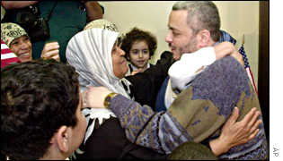 Mazen al-Najjar hugs friends and relatives