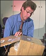 Jeremy Paxman receives the stolen Enigma code machine