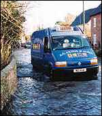 Van driving through floods [WCC photo]