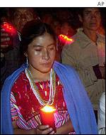 Indians carry candles in memory of 45 peasants killed in the village of Acteal
