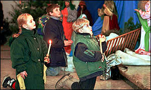 Children kneel during a Christmas Eve church service in Minsk
