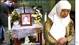 A Muslim woman mourns a Christian casualty of a Jakarta church bombing