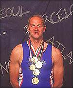 Steve Redgrave shows off his medals