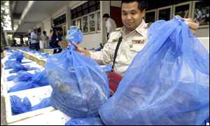 Customs officials with snakes